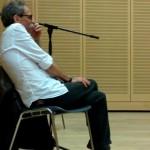 Giuseppe Carini, commissario del bando La prima scuola, ascolta le parole dei premiati al MART
